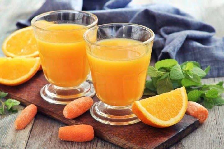 Làm nước uống hạ mỡ máu với cam và cà rốt